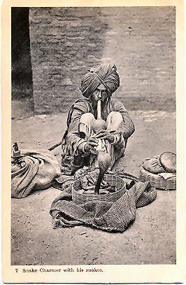 Indian-Snake-Charmer-With-Snakes.jpg